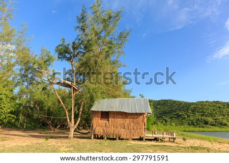 thatched cottage at the beach near mangrove forest - stock photo