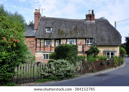 Thatched Cottage In The Cotswold Village Of Bishops Cannings Vale Pewsey Wiltshire