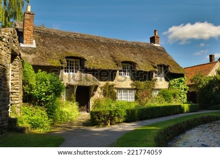 Thatched Cottage, Thornton Le Dale, Yorkshire. - stock photo