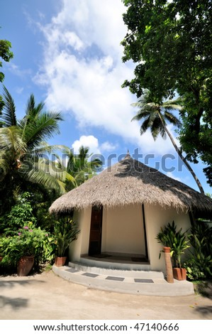 thatched house at maldives - stock photo