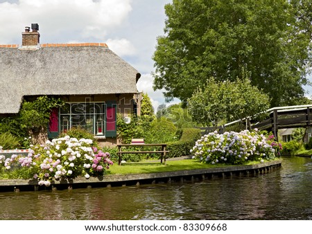 Thatched house near canal in Giethoorn - stock photo