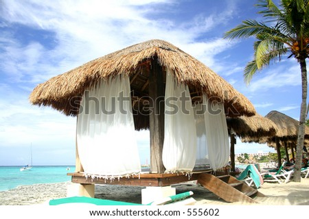 Thatched hut on the beach in Cancun, Mexico - stock photo