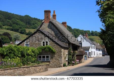 Thatched roadside public house in a Devon village - stock photo