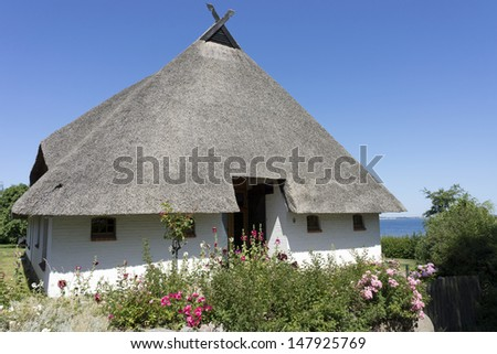 Thatched roof house in the village of Hoben, Germany - stock photo