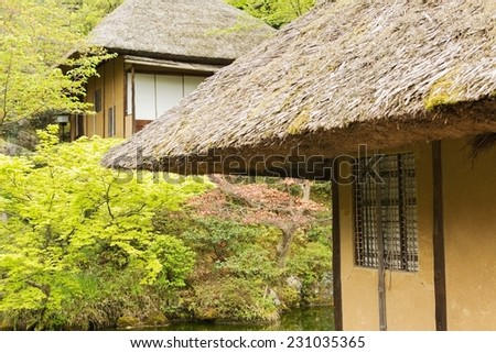 Thatched roof of the house in Kyoto. - stock photo