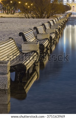 Thaw in winter. Garden benches on Field of Mars. St.-Petersburg, Russia - stock photo