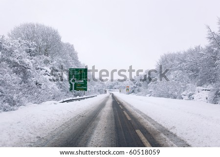 The A31 road at the junction with the A32 roundabout during the snow in January 2010 - stock photo