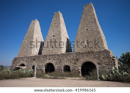 the abandoned medieval smelting ovens in mineral de pozos mexico - stock photo