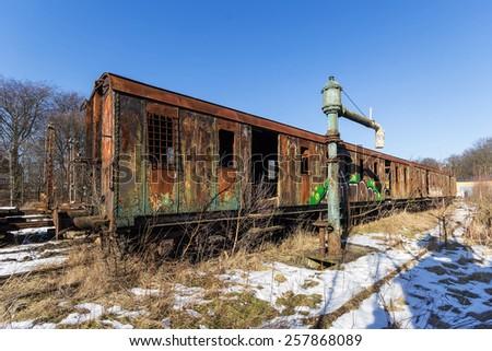 The abandoned old railway wagon - stock photo