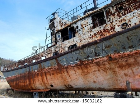 The abandoned old rusty ship - stock photo