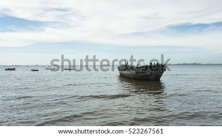 the abandoned ship in evening at Pattaya beach, Chonburi, Thailand