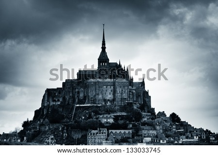 The abbey of Mount Saint Michel island, France, blue colores black and white - stock photo