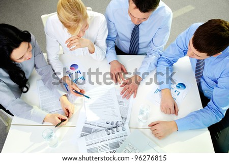 The above view of a business team working with documents - stock photo