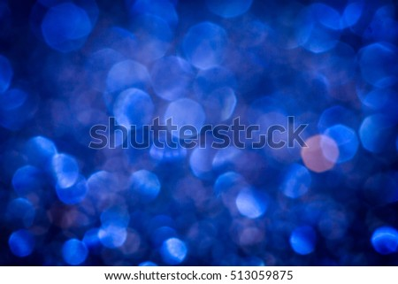 the  Abstract blur  blue bokeh lighting from glitter texture