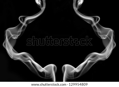 The abstract figure of the smoke on black background - stock photo