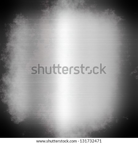 The abstract metal surface darkened at the edges - stock photo