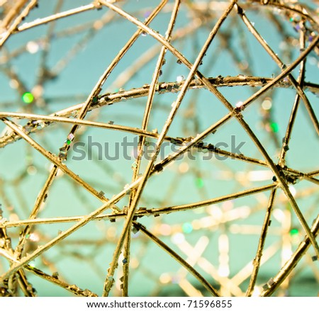 The abstract object from the gold wire forming primitive figures. - stock photo