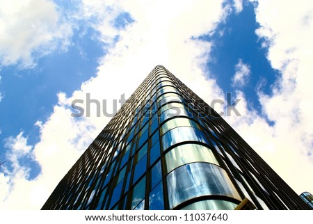 The abstract of steel and glass building reaching the sky (overexposed purposely) - stock photo