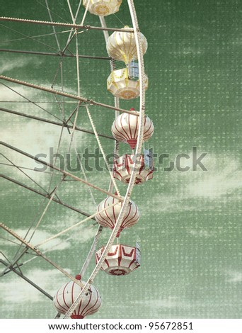 the abstract vintage photo of carnival ferris wheel - stock photo