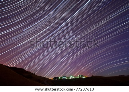 The accumulated star trails above the IBM Almaden Research Center in San Jose, California. - stock photo