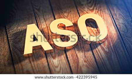"""The acronym """"ASO"""" is lined with gold letters on wooden planks. 3D illustration image - stock photo"""