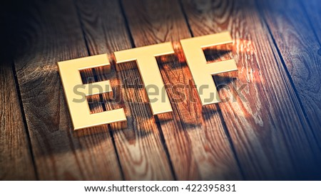 """The acronym """"ETF"""" is lined with gold letters on wooden planks. 3D illustration image - stock photo"""