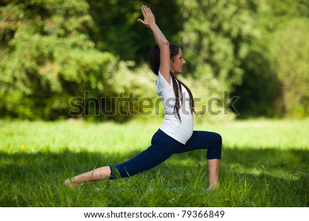 The active pregnant woman does sports exercises in a summer park. Care of health and pregnancy. - stock photo