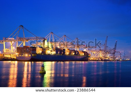 The activity of loading and unloading of huge container ships at the world's biggest and busiest container harbor in Rotterdam - stock photo