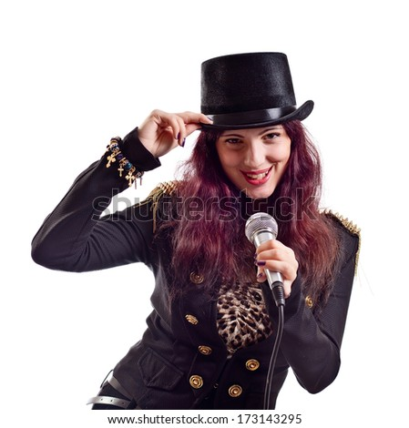 The actress in black suit with microphone, isolated on white