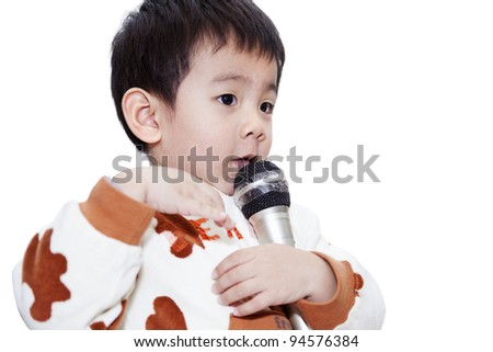 The adorable toddler singing with body languages. - stock photo