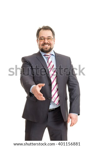 the adult man in a suit costs on a white background and offers a hand for handshake - stock photo