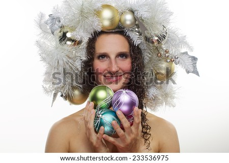 The adult woman is hold new year toys  - stock photo