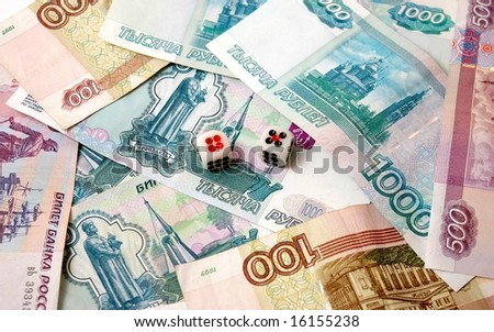 The Advantage.The Paper russian bills and playing cubes. - stock photo