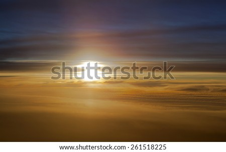 The aerial view of a sunset ten kilometers high in the air.  - stock photo