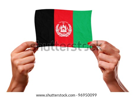 The Afghan flag in the woman hands. closeup - stock photo