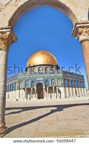 The afternoon sun shines on the golden Dome of the Rock and church steeples in Jerusalme - stock photo