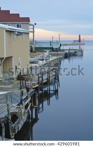 The Ahnapee River flows out of the Door Peninsula and into lake Michigan at Algoma where the entrance to the harbor is guarded by the Algoma Pierhead Light, Algoma, Kewaunee County, Wisconsin - stock photo