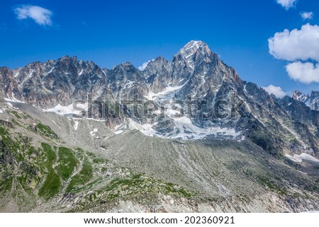 The Aiguille du Moine (l) and the Grande Rocheuse (c) in the french alps above Chamonix - stock photo