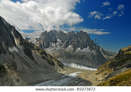 the 'aiguilles de chamonix' or the chamonix needles, above the mer de glace in the french alps, viewed from above the leschaux glacier - stock photo