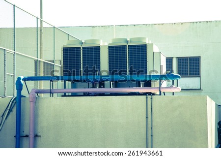 The air conditioning system installed on the roof of the building. Toned.