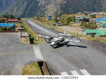 The aircraft on the runway of the Tenzing-Hillary airport Lukla - Nepal - stock photo