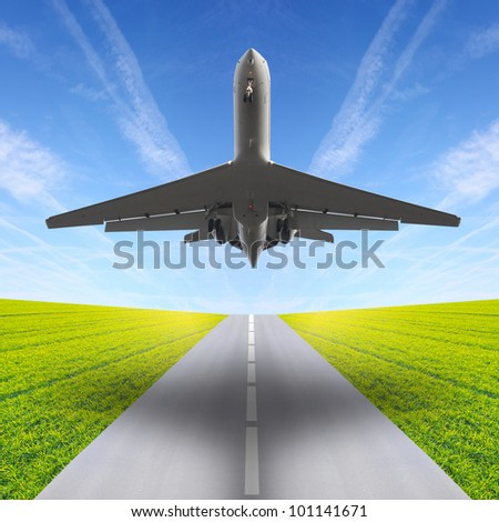 The airliner over a runway. Travel concept. - stock photo