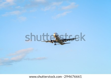The airplane is flying against blue sky