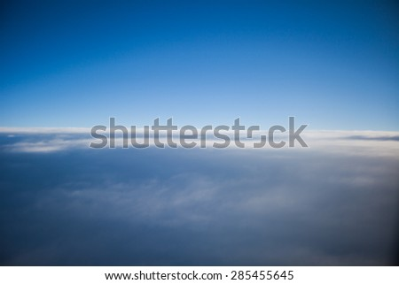 The airplane window on an airplane sky - stock photo