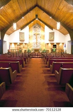 The aisle leading to the alter. - stock photo