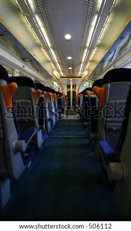 The aisle of a modern railway carriage. - stock photo
