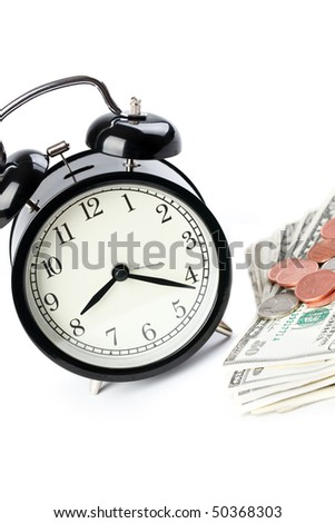 the alarm clock and money on white background
