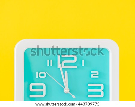 The alarm clock is showing the right time. Midday or midnight. It is about twelve o'clock. - stock photo