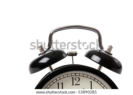 the alarm clock on white background - stock photo