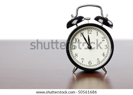 the alarm clock on wooden table - stock photo